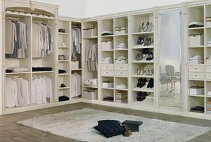 Traditional Closet with Uttermost Willa Pearl Armchair - White, Built-in bookshelf, Hardwood floors