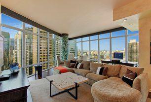 Modern Living Room with Hardwood floors, Columns