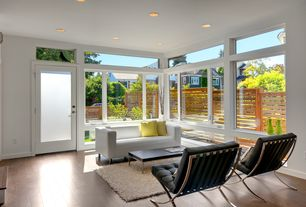 Contemporary Living Room with Hardwood floors, Transom window, French doors