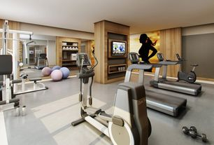 Contemporary Home Gym with Sunny Health & Fitness Anti-Burst Exercise Ball, Columns, Built-in bookshelf, Concrete floors