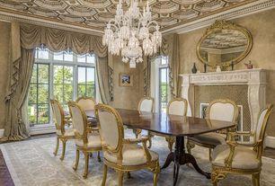 Dining Room with Chandelier, Laminate floors, Glass panel door, Transom window