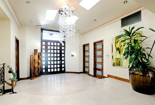 "Modern Entryway with Bubble chandelier, specialty door, Skylight, Faber Applestone Tile 16"" x 16"" Limestone Honed Tile"