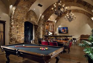 Mediterranean Game Room with Spencer marston tuscany pool table, Custom wrought iron chandelier, Chandelier, Hardwood floors