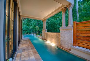 Traditional Swimming Pool with Pathway, French doors, Fence, Fountain, exterior stone floors