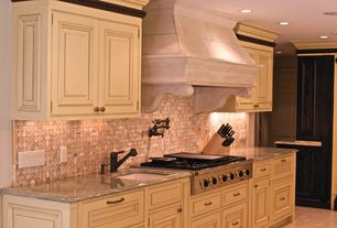 Traditional Kitchen with full backsplash, limestone tile floors, electric cooktop, One-wall, stone tile floors, Custom hood