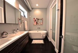 Modern Master Bathroom with Corian counters, specialty door, Laminate floors, Master bathroom, Flush, picture window, Bathtub