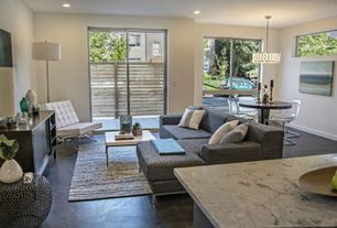 Modern Living Room with Rove concepts barcelona chair, Rove concepts barcelona chair, Concrete floors