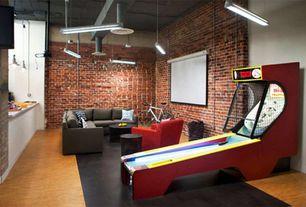 Contemporary Game Room with Standard height, Built-in bookshelf, Carpet, Pendant light, interior brick