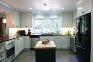 Cottage Kitchen with Flat panel cabinets, Flush, Undermount sink, Wood counters, Simple granite counters, U-shaped, Casement