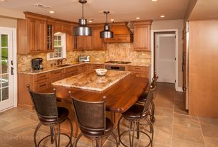 Craftsman Kitchen with Stone Tile, Flush, Undermount sink, stone tile floors, Breakfast bar, Wood counters, French doors