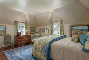 Country Master Bedroom with Hardwood floors, Lois versailles silk nursing chair, Exposed beam, India rug signed ghazan