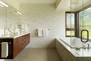 Contemporary Master Bathroom with frameless showerdoor, drop in bathtub, Quartz counters, stone tile floors, Shower, Casement