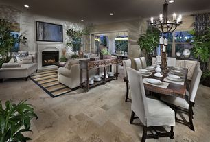 Contemporary Dining Room with Chandelier, Crown molding, limestone floors