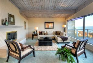 Traditional room with stone fireplace, Carpet, Exposed beam