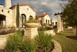 Contemporary Landscape/Yard with exterior stone floors, Louvered door, Pathway, Arbor, Trellis, Raised beds