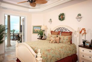 Tropical Guest Bedroom with Ceiling fan, French doors, Crown molding, travertine tile floors, Standard height
