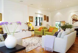 Contemporary Living Room with Hardwood floors, Built-in bookshelf, specialty door