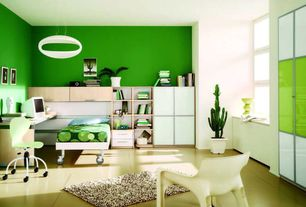 Contemporary Kids Bedroom with Built-in bookshelf, Window seat, Philippe Starck for Kartell Dr. Yes Chairs, Concrete floors