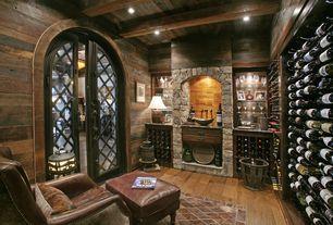Rustic Wine Cellar with Exposed beam, Louvered door, can lights, Built-in bookshelf, Hardwood floors, High ceiling