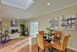 Modern Dining Room with Hardwood floors, Crown molding, can lights, Standard height
