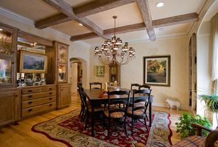 Country Dining Room with Standard height, Chandelier, can lights, Crown molding, Hardwood floors, Exposed beam