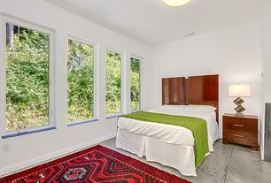 Contemporary Guest Bedroom with flush light, sandstone floors