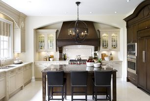 """Traditional Kitchen with Kitchen island with seating, Complex granite counters, Wolfe - 36"""" dual fuel range - 6 burners"""