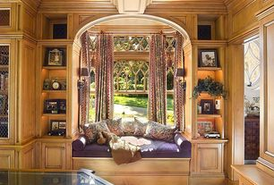 Traditional Living Room with Crown molding, Hardwood floors, Standard height, Window seat, Built-in bookshelf