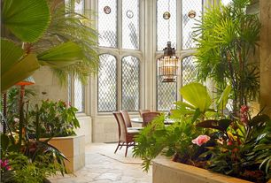 Tropical Hallway with High ceiling, slate floors, Pendant light, Arched window