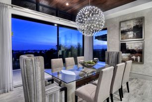 Modern Dining Room with Standard height, Hardwood floors, Raimond suspension light, picture window, can lights, Chandelier