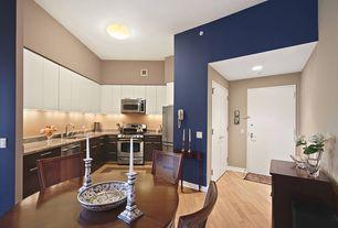 Traditional Great Room with flush light, can lights, Hardwood floors, Standard height, flat door, Built-in bookshelf