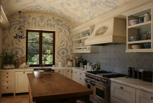 Eclectic Kitchen with Kitchen island, Farmhouse sink, mexican tile backsplash, Inset cabinets, Flat panel cabinets, L-shaped