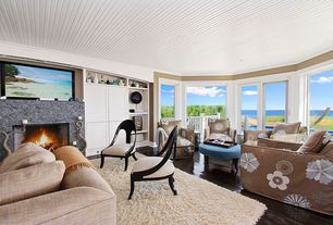 Contemporary Living Room with Built-in bookshelf, Safavieh Cozy Solid Shag Rug, stone fireplace, Hardwood floors