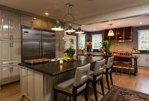 Traditional Kitchen with Maple - caramel 5 in. engineered hardwood wide plank, French doors, Soapstone counters, L-shaped