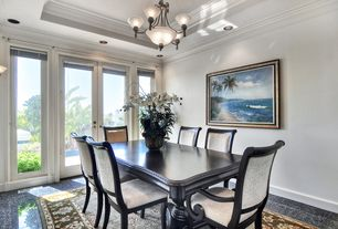 Tropical Dining Room with Dolan Designs Lighting Bronze Chandelier with Center Bowl, Crown molding, Wall sconce, French doors
