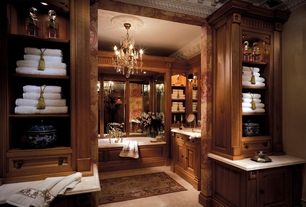 Traditional Master Bathroom with Limestone counters, interior wallpaper, Clive Christian Interiors Cabinetry, Undermount sink
