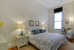 Modern Master Bedroom with can lights, double-hung window, Hardwood floors, High ceiling