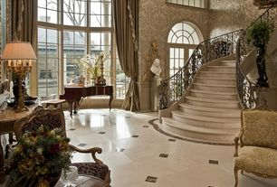 Traditional Staircase with sandstone floors, interior wallpaper, High ceiling