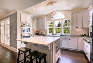 Traditional Kitchen with Breakfast bar, High ceiling, Chandelier, Flat panel cabinets, French doors, Kitchen island, U-shaped