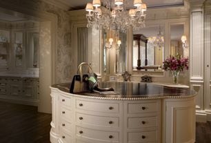 Traditional Closet with Chandelier, interior wallpaper, Crown molding, Hardwood floors, Wall sconce, Curved front cabinets