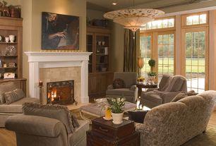 Traditional Living Room with Hardwood floors, Transom window, Built-in bookshelf, stone fireplace, sliding glass door