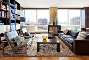 Contemporary Living Room with Hardwood floors, interior wallpaper, Built-in bookshelf, Window seat