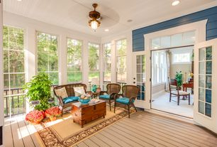 Traditional Porch with Transom window, French doors, Pathway, Carino hardwood trunk table, Ceiling fan, Screened porch