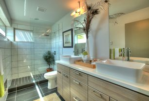 Contemporary 3/4 Bathroom with Corian counters, Flush, European Cabinets, George Kovacs Saber 2 Light Wall Sconce