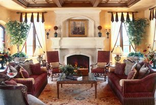 Mediterranean Living Room with Wall sconce, Cement fireplace, Carpet, Standard height, Casement, Box ceiling, Fireplace