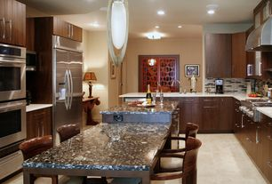 Contemporary Kitchen with limestone tile floors, Glass panel, Ceramic Tile, Undermount sink, Flush, Corian counters, U-shaped