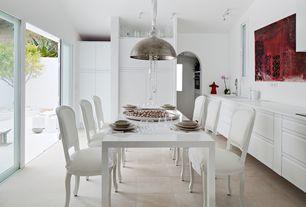 Contemporary Dining Room with stone tile floors, limestone tile floors, Standard height, Built-in bookshelf, flush light
