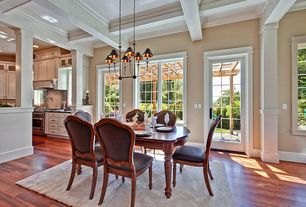 Traditional Dining Room with Casement, Crown molding, French doors, Box ceiling, Hardwood floors, Columns, Chandelier
