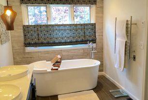 Contemporary Full Bathroom with Freestanding, High ceiling, Double sink, Vessel sink, Pendant light, slate tile floors, Flush