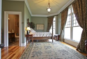 Traditional Guest Bedroom with Hardwood floors, Crown molding, Pendant light